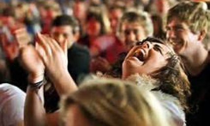 cropped-laughing-audience-lady.jpg